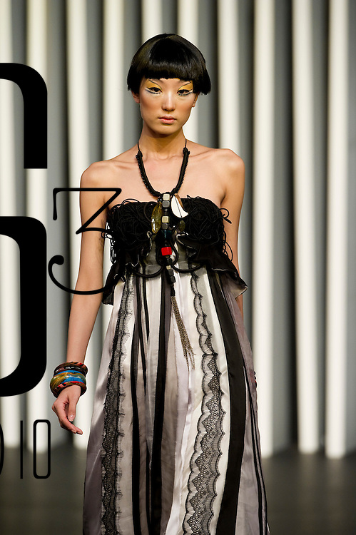 HONG KONG - JULY 05:  A model displays a creation of Indonesian designer Ali Charisma during the 'Live It' show as part of the Hong Kong Fashion Week Spring/Summer 2010/11 at the Hong Kong Convention and Exhibition Center on July 5, 2010 in Hong Kong, China.  Photo by Victor Fraile / studioEAST