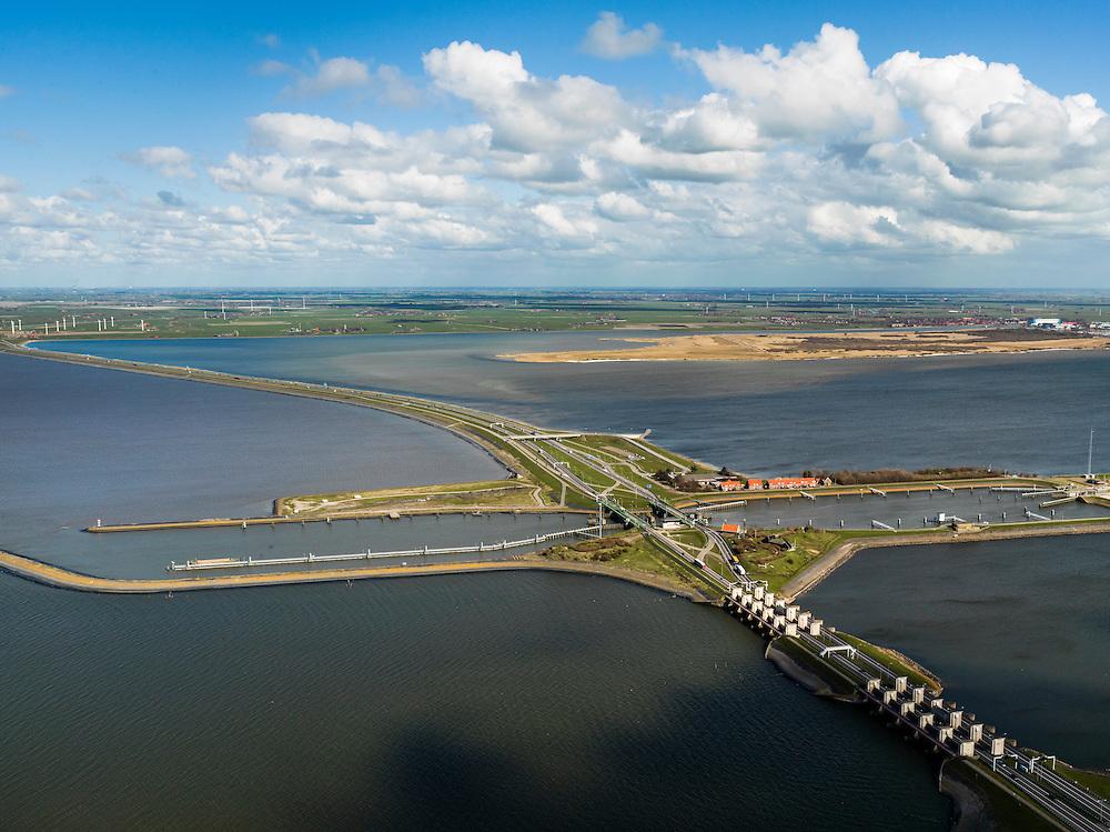 Nederland, Friesland, Gemeente Wonseradeel, 16-04-2012; Afsluitdijk ter hoogte van Kornwerderzand, gezien naar de kust van Friesland. Op het voormalig werkeiland liggen de Lorentzsluizen, een complex van spuisluizen en schutsluizen. De spuisluizen (uitwaterende sluizen) lozen van het IJsselmeer op de Waddenzee (links). De sluizen worden beschermd door kazematten (bunkers). echts natuurreservaat De Makkumer noordwaard..Enclosure Dam at the height of Kornwerderzand seen in the direction of the coast of Friesland. On the former work island the Lorentz locks, a complex of sluices and locks. The sluices sluice surplus water to the Wadden sea (l). The locks are protected by bunkers..luchtfoto (toeslag), aerial photo (additional fee required).foto/photo Siebe Swart
