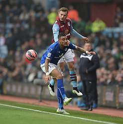 Aston Villa's Andreas Weimann heads the ball past Leicester City's Danny Simpson - Photo mandatory by-line: Alex James/JMP - Mobile: 07966 386802 - 15/02/2015 - SPORT - Football - Birmingham - Villa Park - Aston Villa v Leicester City - FA Cup - Fifth Round