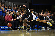 Nov 6, 2019; Los Angeles, CA, USA; UCLA Bruins guard Jules Bernard (white) and Long Beach State 49ers guard Drew Cobb (black) battle for the ball in the first half at Pauley Pavilion.