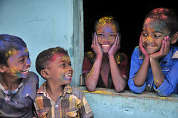 March 22, 2019 - Bangladeshi Tea garden children posing with smile after adorning with colors on the celebration of the annual hindu festival of colours, known as Holi festival marking the onset of spring in Sylhet, Bangladesh. (Credit Image: © Md Rafayat Haque Khan/ZUMA Wire)