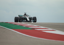 October 20, 2018 - Austin, USA - Mercedes AMG Petronas driver Lewis Hamilton (44) of Great Britain tops the hill at Turn 10 during qualifying at the Formula 1 U.S. Grand Prix at the Circuit of the Americas in Austin, Texas on Saturday, Oct. 20, 2018. Hamilton set a new track record and earned pole position for the Grand Prix on Sunday. (Credit Image: © Scott Coleman/ZUMA Wire)
