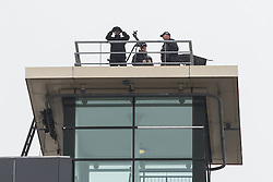 "© Licensed to London News Pictures . 03/10/2015 . Manchester , UK . Police with guns on a rooftop . A "" ring of steel "" and police on the roads around the Manchester Central Convention Centre where the Conservative Party are holding their annual conference . Photo credit: Joel Goodman/LNP"