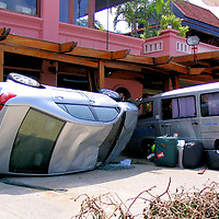 Overturned Car and Van with Luggage After Tsunami on Patong Beach in Phuket, Thailand <br />
