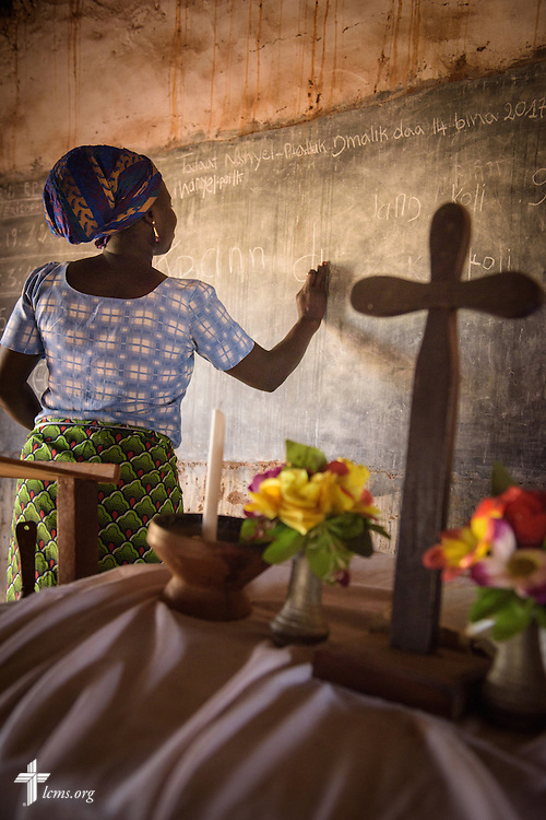 A literacy project class member writes words on the chalkboard at the Lutheran Church of Togo in Kpierik on Tuesday, Feb. 14, 2017, in Kpierik, Togo. LCMS Communications/Erik M. Lunsford
