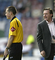 Photo: Aidan Ellis.<br /> Huddersfield Town v Yeovil Town. Coca Cola League 1. 29/04/2006.<br /> Huddersfield manager Peter Jackson has a go at the linesman