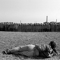 Picket laying down in front of police with riot shields at Orgreave during the 1984/85 miners'strike. 18 June 1984
