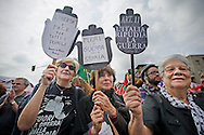 Rome apr 25th 2015, 70° anniversary of the liberation from nazism and fascism, demo in Piazzale Ostiense, the place were begin the Resistance in Rome. In the picture some women hold notes against the war - © PIERPAOLO SCAVUZZO