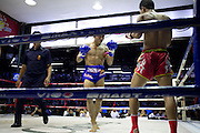 Muay Thai (Thai Kick boxing) matches at Lumphini Stadium in Bangkok, Thailand. Matches are held here 3 times a week with a mix of classes being represented each night. Lumphini is one of the 2 biggest venues for Muay Thai matches in Bangkok.