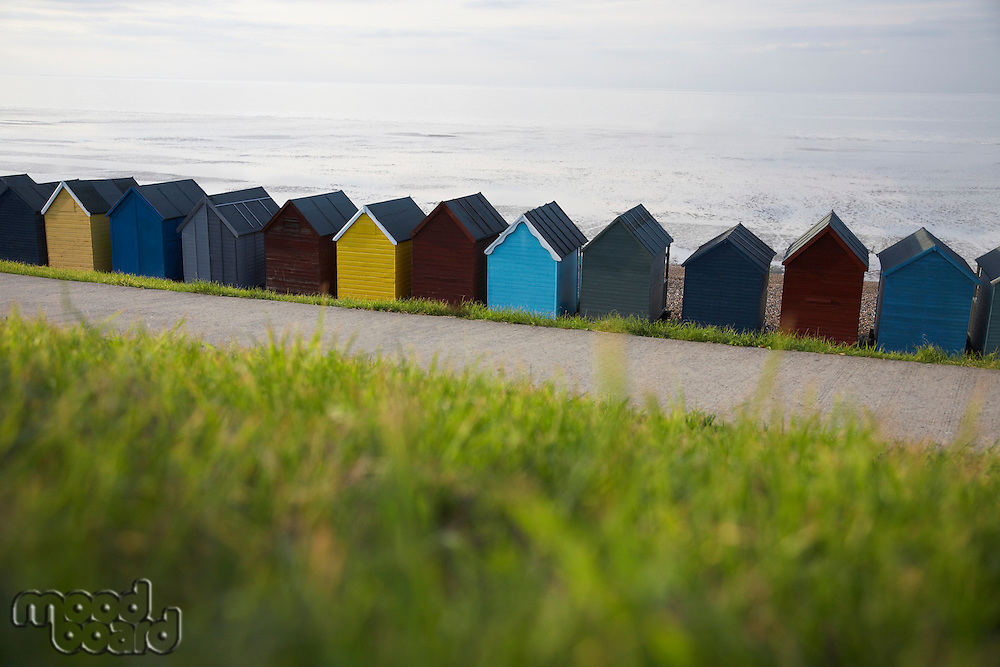 Beach huts lined up along beach back view