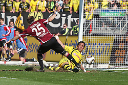 24.04.2010, easyCredit Stadion, Nuernberg, GER, 1. FBL, 1 FC Nuernberg vs Borussia Dortmund, im Bild: .Lucas Barrios (Dortmund #18) macht das 1:3 gegen Javier Horacio Pinola (Nuernberg #25).EXPA Pictures © 2010, PhotoCredit: EXPA/ nph/  news / SPORTIDA PHOTO AGENCY