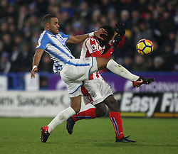 Mathias Zanka Jorgensen of Huddersfield Town (L) and Mame Biram Diouf of Stoke City in action - Mandatory by-line: Jack Phillips/JMP - 26/12/2017 - FOOTBALL - The John Smith's Stadium - Huddersfield, England - Huddersfield Town v Stoke City - English Premier League