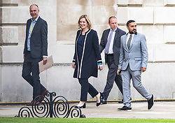 © Licensed to London News Pictures. 31/05/2017. Cambridge, UK. Home Secretary AMBER RUDD (2L) is seen at Senate House in Cambridge ahead of the BBC General Election Debate. Photo credit: Rob Pinney/LNP
