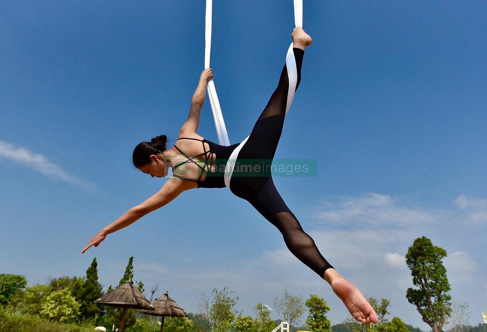 July 16, 2018 - Ganzhou, Ganzhou, China - Ganzhou, CHINA-A woman practices anti-gravity in Ganzhou, east China's Jiangxi Province. (Credit Image: © SIPA Asia via ZUMA Wire)