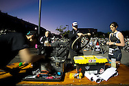 In The Pre-Dawn Conditions THe Specialized Bikes Crew Assist With Last Minute Repairs In Transition Before The Swim Start. 2012 Ironman Cairns Triathlon. Cairns, Queensland, Australia. 03/06/2012. Photo By Lucas Wroe.