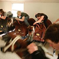 Students at the North American Racing Academy work out on mechanical horses, meant to emulate riding a real horse, as part of their conditioning exercises at the Thoroughbred Center in Lexington, Ky., on Monday, March 26, 2012.  Photo by David Stephenson