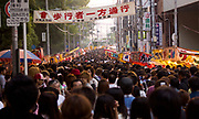 One part of the crowd looking for snacks and cool drinks at the Tenjin Festival in Osaka. There would be more than 100,000 people in this section alone.
