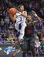 Guard Kamau Stokes #3 of the Kansas State Wildcats drives to the basket past center L'Hassane Niangane #31 of the Gardner-Webb Bulldogs during the second half at Bramlage Coliseum in Manhattan,