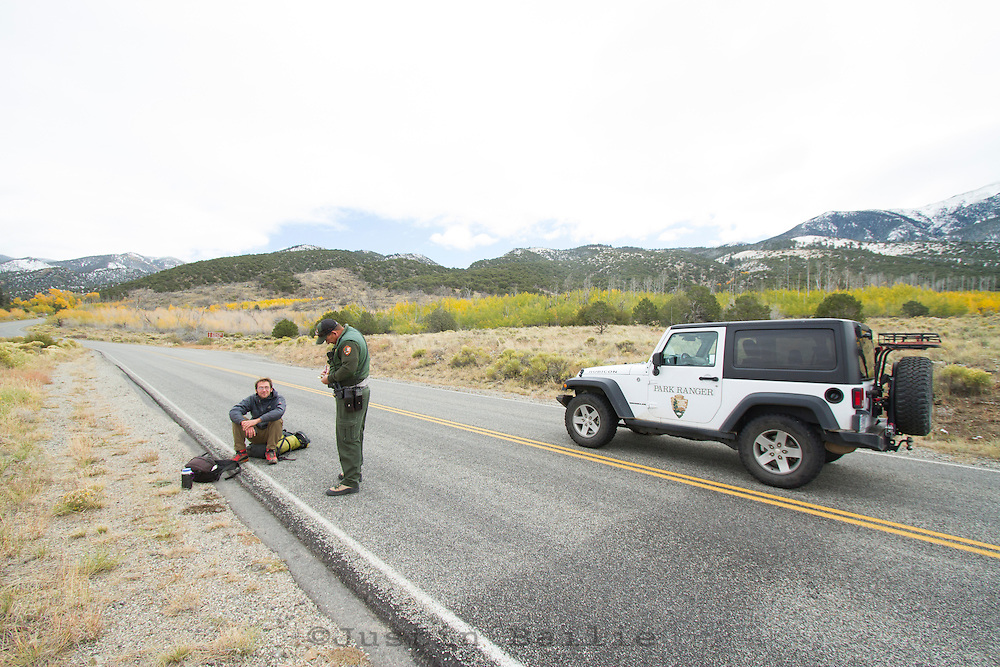 Ranger talking with young man who has entered Great Sand Dunes National Park while it is closed during the 2013 government shutdown in, CO.