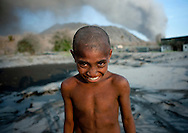 Kid Under A Volcanic Eruption In Tavurvur Volcano, Rabaul, New Britain Island, Papua New Guinea
