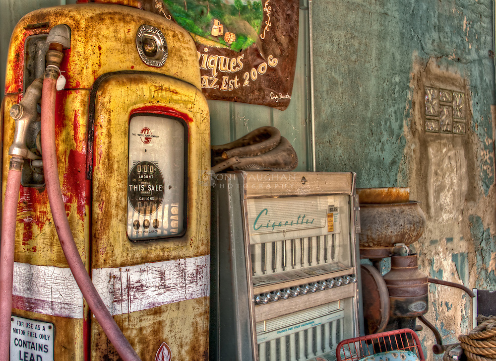 Vintage gas pump and cigarette machine at antique store in Arizona