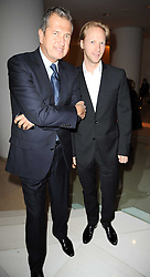 Left to right, MARIO TESTINO and  at a party to celebrate Lancome's 10th anniversary of sponsorship of the BAFTA's in association with Harper's Bazaar magazine held at St.Martin's Lane Hotel, London on 19th February 2010.