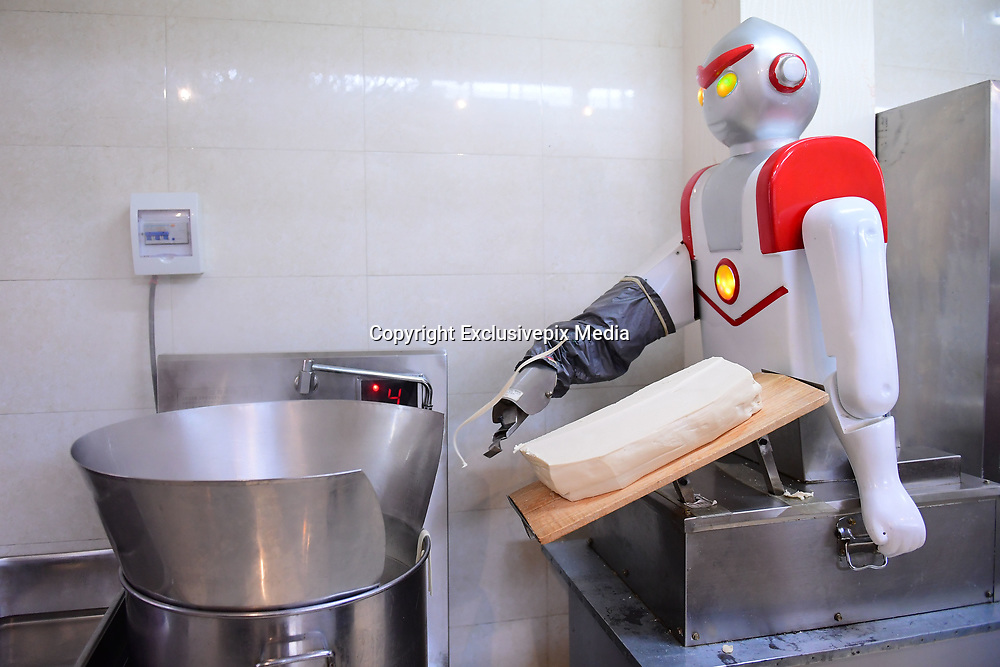 SHENYANG, CHINA - MAY 09: <br /> <br /> Robots Shave Noodles At  School Canteen <br /> <br /> A robot slices noodles for students at Shenyang Agricultural University on May 9, 2017 in Shenyang, Liaoning Province of China. Sliced noodles made by the two robots serve in the school canteen of Shenyang Agricultural University. <br /> &copy;Exclusivepix Media