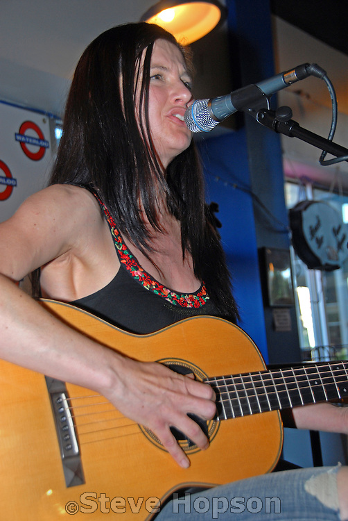 Brandi Shearer performing at Waterloo Records in Austin Texas, May 19 2008. Brandi Shearer is an American singer who records for Amoeba Records. Her debut album, Close to Dark, was released in 2007 and produced by Larry Klein.  Waterloo Records is an independent music store in Austin Texas, and was selected by Rolling Stone Magazine as one of the best record stores in 2008.