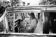 In an unusual move, Khrushchev sat down in the front seat of his limousine.<br /> <br /> <br /> Dans un geste inhabituel, Khrouchtchev s'est assis sur le si&egrave;ge avant de sa limousine.
