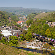 A Northern Rail train crossing Gauxholme viaduct, near Todmorden, on its way from Littleborough to Todmorden. Gauxholme viaduct has 17 spans which carry the Leeds to Manchester railway line over the Rochdale Canal.
