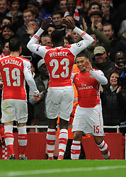 Arsenal's Alex Oxlade-Chamberlain celebrates his goal with Arsenal's Danny Welbeck and Arsenal's Santi Cazorla - Photo mandatory by-line: Dougie Allward/JMP - Mobile: 07966 386802 - 04/11/2014 - SPORT - Football - London - Emirates Stadium - Arsenal v RSC Anderlecht - Champions League - Group D