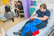 Her Royal Highness meets Charley Saunders, 18 from Poplar (pictured in black), and Danny Roberts, 13 from Maida Vale (pictured R), on the ward. The Duchess of Cornwall, Patron, Arthritis Research UK, visits and meets patients of the Adolescent Inpatient Unit at University College London Hospitals.  •	Her Royal Highness then tours a laboratory at the Arthritis Research UK Centre for Adolescent Rheumatology and meeting researchers and supporters. London 12 Feb 2015.