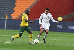 South Africa: Johannesburg: Bafana Bafana player Aubrey Bodiba battle for the ball with Seychelles player Karl Hopprich during the Africa Cup Of Nations qualifiers at FNB stadium, Gauteng.<br />