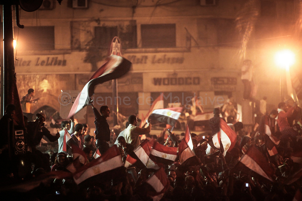 Pro-democracy protesters in an around Cairo's Tahrir Square exploded with joy after announcement of President Hosni Mubarak stepping down. 11 February 2011.