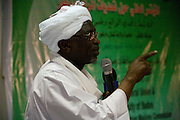 The Govenor of North Darfur, Osman Mohammed Yousef Kibir addresses the first-ever international Conference on Womens' Challenge in Darfur. The women have gathered in the Govenor's own compound in Al Fasher (also spelled, Al-Fashir) where the women from remote parts of Sudan gathered to discuss peace and political issues.