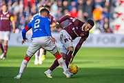 James Tavernier (#2) of Rangers FC tackles Jake Mulraney (#11) of Heart of Midlothian FC during the Ladbrokes Scottish Premiership match between Heart of Midlothian and Rangers FC at Tynecastle Park, Edinburgh, Scotland on 20 October 2019.