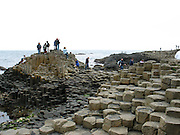 Giant's Causeway is the only World Heritage Site in Ireland.An area of about 40,000 interlocking basalt columns, the result of an ancient volcanic eruption. It is located in County Antrim on the northeast coast of Northern Ireland, about 3 km north of the town of Bushmills. It was declared a World Heritage Site by UNESCO in 1986, and a National Nature Reserve in 1987.<br />  er et omr&aring;de p&aring; Antrim -kysten i Nord-Irland med formasjoner best&aring;ende av noe n&aelig;r 40 000 sorte polygone (de fleste sekskantede) basalt -s&oslash;yler. Fenomenet er et resultat av et underjordisk vulkanutbrudd for 60 millioner &aring;r siden. Northern Ireland, Nord-Irland, Belfast, Europe, country, land, war, struggle, island,