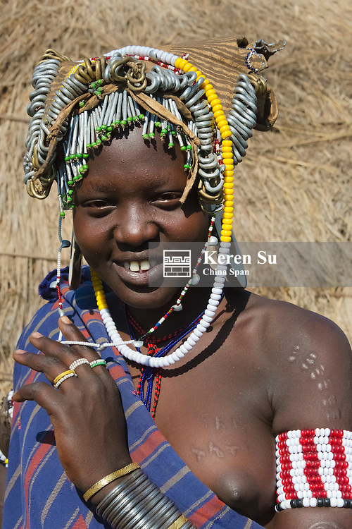 Mursi tribe people in traditional clothing, Mursi Village, South Omo, Ethiopia