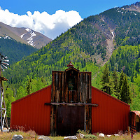 Red Shed and Weathervane at Independence Pass, Colorado <br /> This highway maintenance shed with its antique weathervane is the rare operative building you will see along Independence Pass. However, in the Roaring Fork Valley, you can visit the remnants of ghost town including simple wood cabins, the Farewell Stamp Mill and a general store. These are all that is left of Independence, a miners' settlement founded on July 4, 1879 at the start of the Colorado Gold Rush.