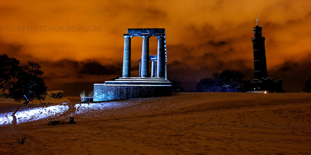 EDINBURGH, UK - 3rd December 2010: Night shots taken on Calton Hill in Edinburgh after a day of heavy snow fell across Edinburgh on Thursday 2nd December 2010. ..Heavy snow has fallen across large parts of the UK, disrupting travel.  Weather warnings of heavy and drifting snow are also in place for many places across the UK...Picture shows a night shot of a snow covered National Monument, Nelsons  Monument and Calton Hill in Edinburgh. ..(Photograph: Richard Scott/MAVERICK)