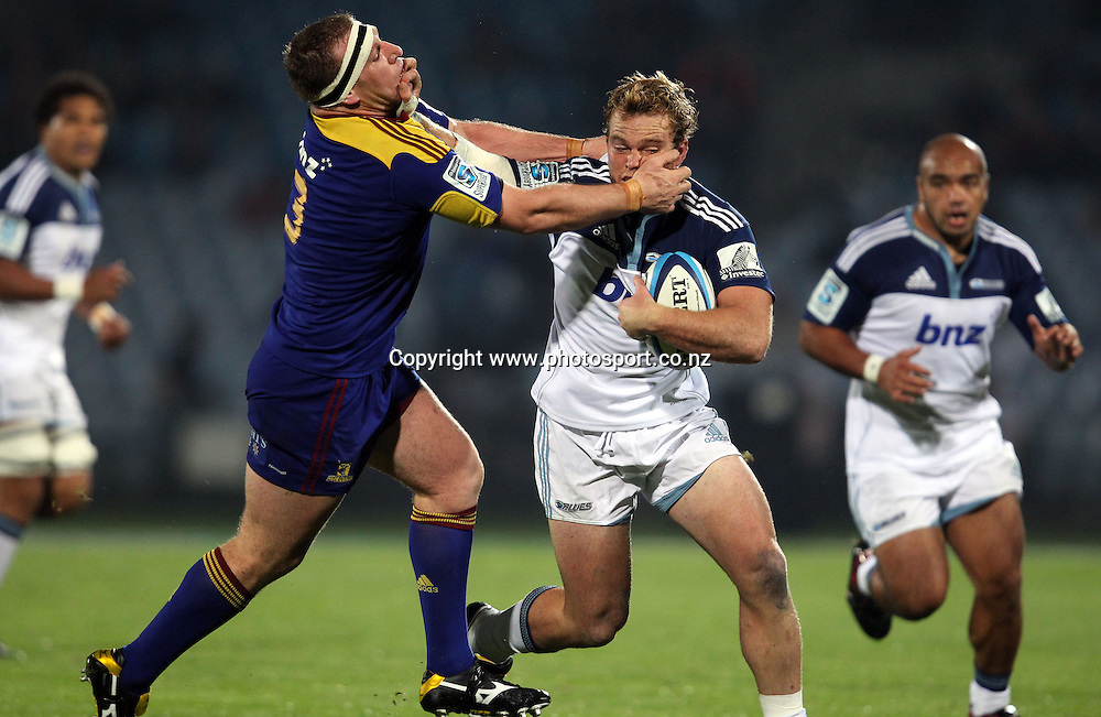 Luke Braid fends off Chris King.<br /> Investec Super Rugby - Highlanders v Blues, 29 April 2011, Carisbrook Stadium, Dunedin, New Zealand.<br /> Photo: Rob Jefferies / www.photosport.co.nz
