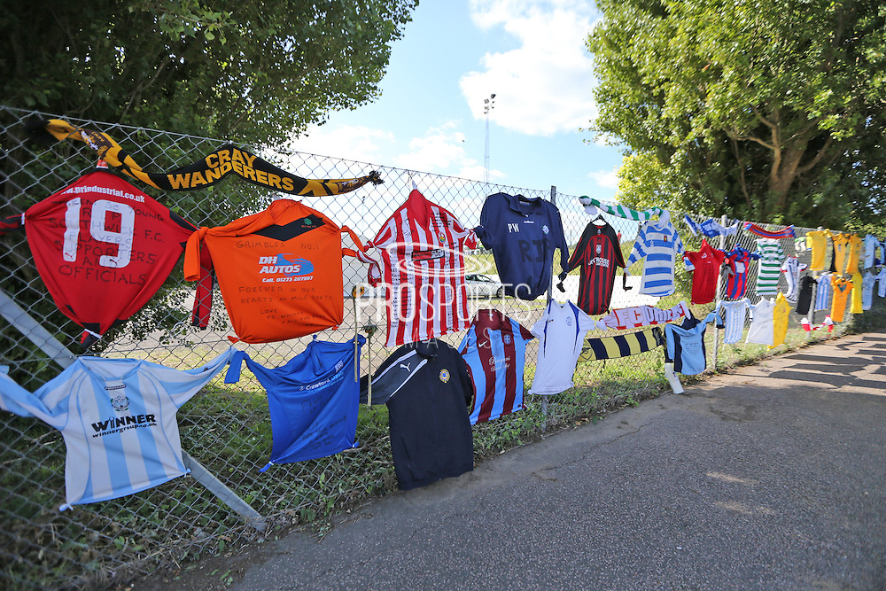 Tributes to Matt Grimstone and Jacob Schilt along the perimeter fence before the FA Vase 1st Qualifying Round match between Worthing United and East Preston FC at the Robert Eaton Memorial Ground, Worthing, United Kingdom on 6 September 2015. The first home match for Worthing United since losing team mates Matthew Grimstone and Jacob Schilt in the Shoreham air show disaster.