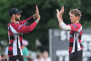 Max Waller and Peter Trego celebrate during the NatWest T20 Blast South Group match between Middlesex County Cricket Club and Somerset County Cricket Club at Uxbridge Cricket Ground, Uxbridge, United Kingdom on 26 June 2015. Photo by David Vokes.