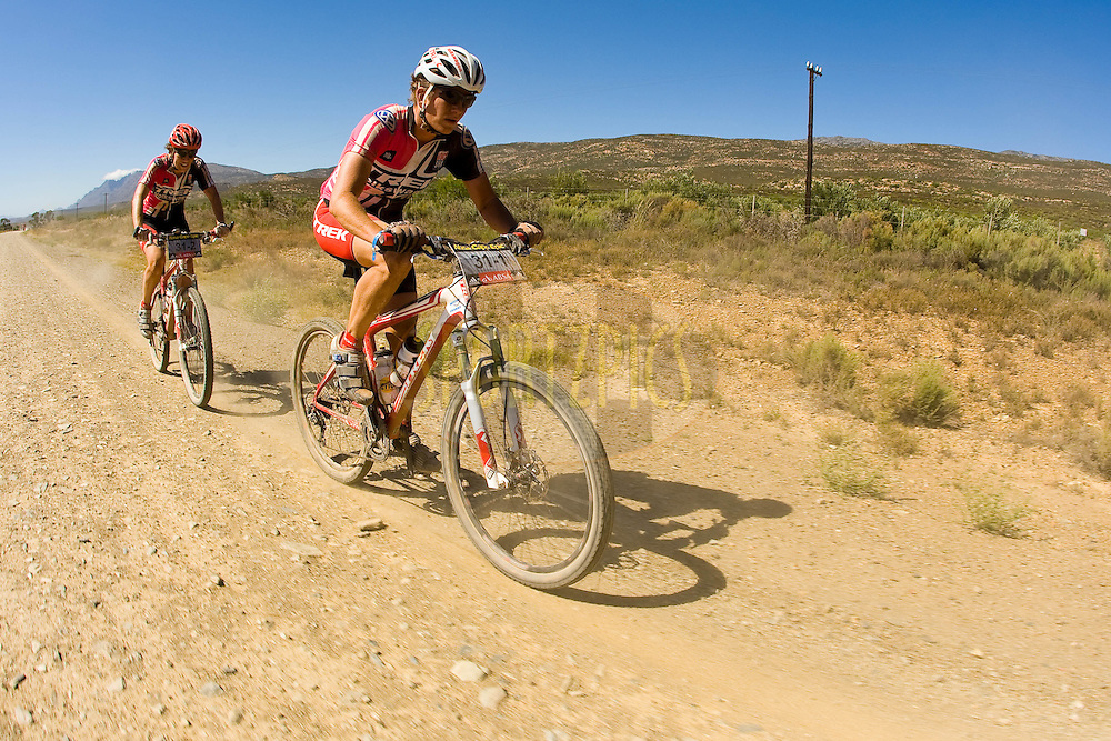 WESTERN CAPE, SOUTH AFRICA -  31 March 2008, USA's Trek VW riders Sue Haywood and Jennifer Smith during stage three of the 2008 Absa Cape Epic Mountain Bike stage race from Calitzdorp Spa.to Langenhoven High School in Riversdale, Western Cape, South Africa..Photo by Sven Martin/SPORTZPICS