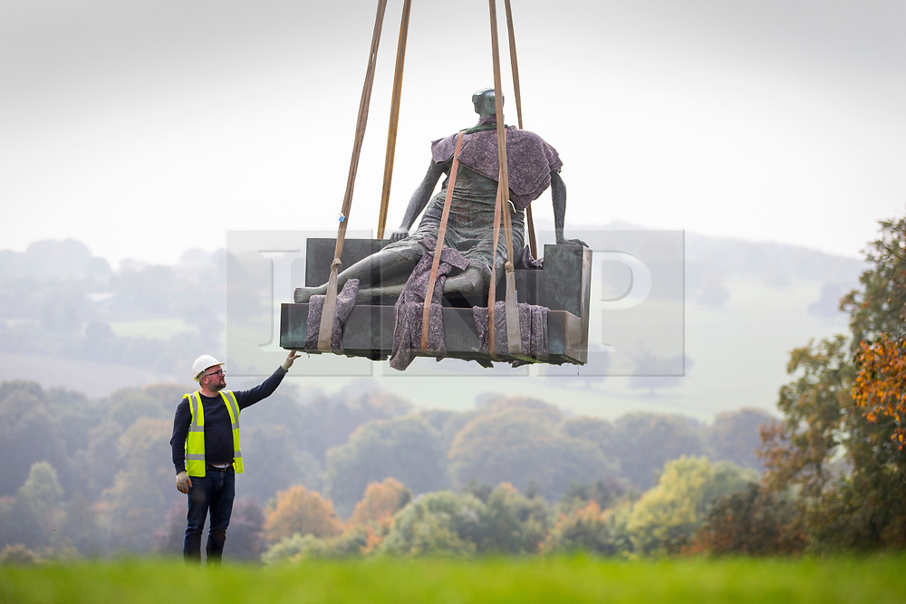 © Licensed to London News Pictures. 26/09/2017. Wakefield UK. Henry Moore's sculpture Draped Seated Woman 1957, affectionately known as 'Old Flo' is being removed from the Yorkshire Sculpture park today after 20 years on public display at the park. The iconic sculpture was loaned to YSP by the London Borough of Tower Hamlets in 1997, after the Stifford Estate in Stepney where it had been located since 1962 was demolished. The sculpture will be returning to Tower Hamlets to be sited in a new home in Cabot Square, Canary Wharf. The return of the sculpture to London marks an end to a bitter political battle over Old Flo. In 2012 the disgraced former mayor of Tower Hamlets Lutfur Rahman, declared that it should be sold to raise £20m, that sparked protests & a court battle over who actually owned the sculpture. Tower Hamlets was confirmed as the legal owner in 2015. Photo credit: Andrew McCaren/LNP