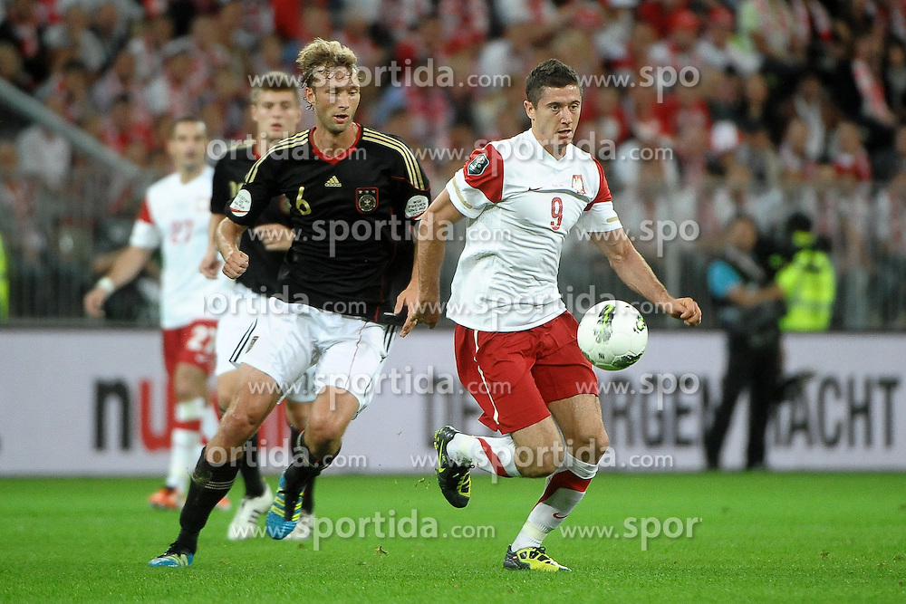 06.09.2011, PGE Arena, Danzig, POL, FSP, Polen vs Deutschland, im Bild SIMON ROLFES, ROBERT LEWANDOWSKI// during the international frindly football game between Poland and Germany at PGE Arena Gdansk Poland on 2011-09-06. EXPA Pictures © 2011, PhotoCredit: EXPA/ Newspix/ Norbert Barczyk +++++ ATTENTION - FOR AUSTRIA/(AUT), SLOVENIA/(SLO), SERBIA/(SRB), CROATIA/(CRO), SWISS/(SUI) and SWEDEN/(SWE) CLIENT ONLY +++++