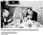Clinton advisor James Carville, Anna Nicole Smith and Oliver Stone sitting together at Producer Steve Tisch &  Vanity Fair's Oscar Night Party,<br />Mortons,  Los Angeles. March 1994.  Film 94555/3<br /> <br />© Copyright Photograph by Dafydd Jones<br />66 Stockwell Park Rd. London SW9 0DA<br />Tel 0171 733 0108.