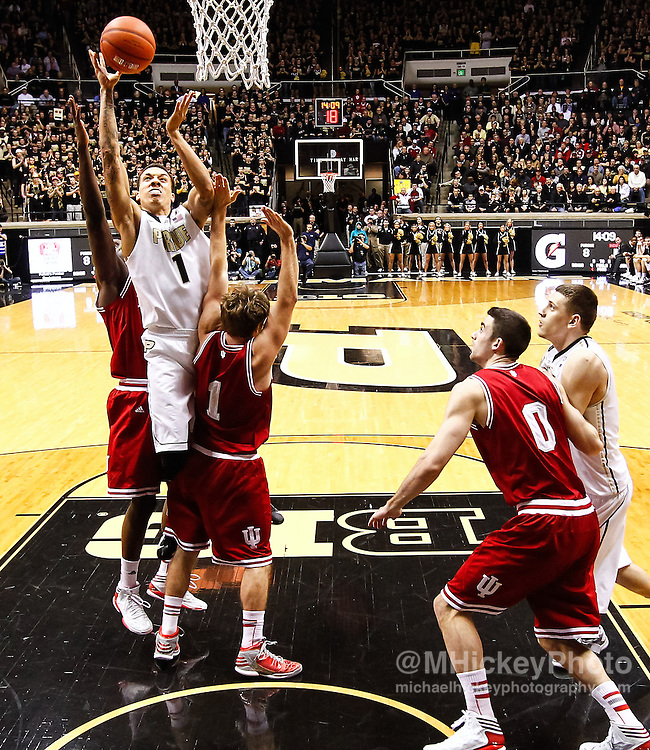 WEST LAFAYETTE, IN - JANUARY 30: Anthony Johnson #1 of the Purdue Boilermakers goes up to shoot over Jordan Hulls #1 of the Indiana Hoosiers at Mackey Arena on January 30, 2013 in West Lafayette, Indiana. Indiana defeated Purdue 97-60. (Photo by Michael Hickey/Getty Images) *** Local Caption *** Anthony Johnson; Jordan Hulls