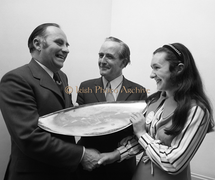 "B.I.M.National Seafood Cook..1972..05.05.1972..05.05.1972..5th May 1972..The final of the ""National Seafood Cook 1972"" was held in the Great Southern Hotel,Killarney,Co Kerry.The winner was Miss Mary Coleman (14 years)from the Vocational School, Claremorris,Co Mayo.The title of the winning dish was ""Amber Ring. She was chosen from 18 regional finalists...Picture of Mr Jackie Fahy TD,(left),Parliamentary Secretary to the Minister for Agriculture, presenting the Perpetual Challenge Trophy and a cheque fur £150 to the winner Ms Mary Coleman,Claremorris,Co Mayo. Included in the picture is Mr T F Geoghegan,Market Development manager,Bord Iascaigh Mhara (B.I.M.)"