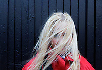 Young blond woman in the wind